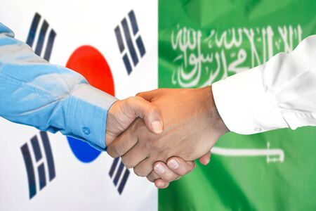 Business handshake on the background of two flags. Men handshake on the background of the South Korea and Saudi Arabia flag. Support concept Stok Fotoğraf