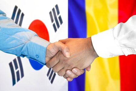 Business handshake on the background of two flags. Men handshake on the background of the South Korea and Moldova flag. Support concept Stok Fotoğraf