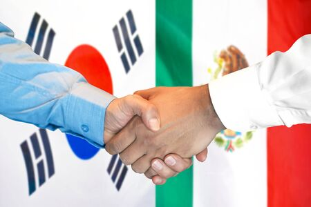 Business handshake on the background of two flags. Men handshake on the background of the South Korea and Mexico flag. Support concept Stok Fotoğraf