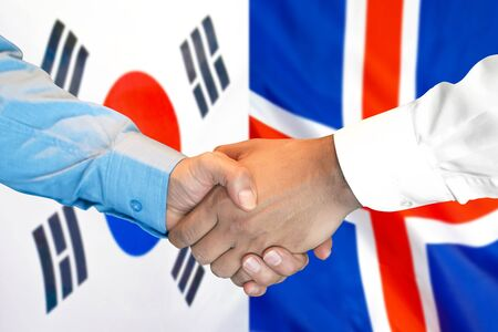 Business handshake on the background of two flags. Men handshake on the background of the South Korea and Iceland flag. Support concept