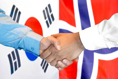 Business handshake on the background of two flags. Men handshake on the background of the South Korea and Norway flag. Support concept