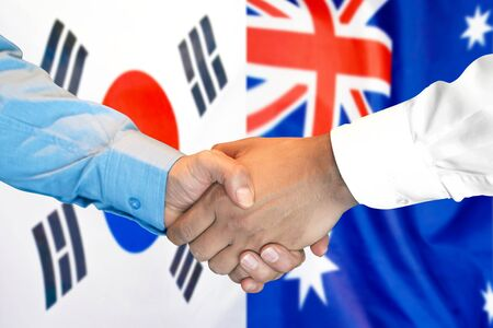Business handshake on the background of two flags. Men handshake on the background of the South Korea and Australia flag. Support concept Stok Fotoğraf