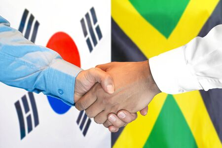 Business handshake on the background of two flags. Men handshake on the background of the South Korea and Jamaica flag. Support concept