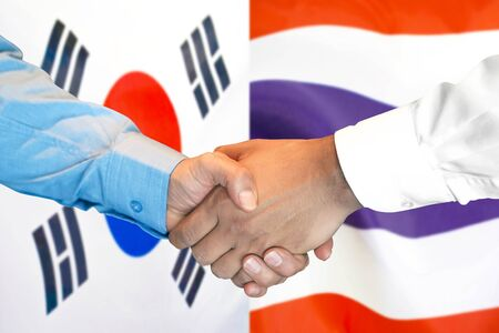 Business handshake on the background of two flags. Men handshake on the background of the South Korea and Thailand flag. Support concept