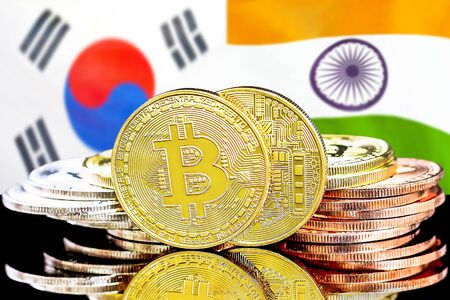 Concept for investors in cryptocurrency and Blockchain technology in the South Korea and India. Bitcoins on the background of the flag South Korea and India.