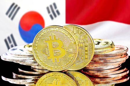 Concept for investors in cryptocurrency and Blockchain technology in the South Korea and Monaco. Bitcoins on the background of the flag South Korea and Monaco.