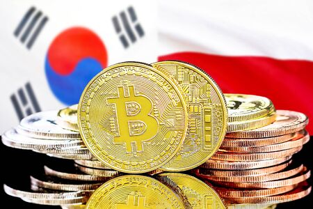 Concept for investors in cryptocurrency and Blockchain technology in the South Korea and Poland. Bitcoins on the background of the flag South Korea and Poland.