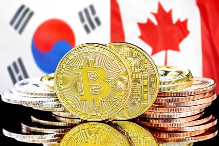 Concept for investors in cryptocurrency and Blockchain technology in the South Korea and Canada. Bitcoins on the background of the flag South Korea and Canada.