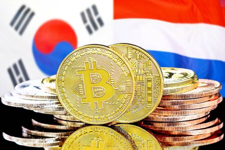 Concept for investors in cryptocurrency and Blockchain technology in the South Korea and Dutch. Bitcoins on the background of the flag South Korea and Netherlands. Stok Fotoğraf