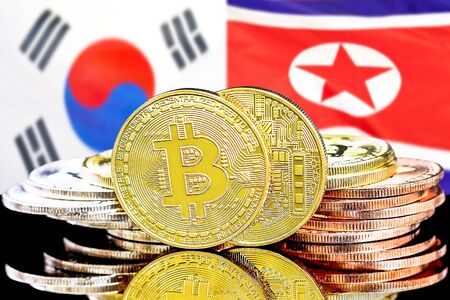 Concept for investors in cryptocurrency and Blockchain technology in the South Korea and North Korea. Bitcoins on the background of the flag South Korea and North Korea.