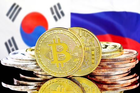 Concept for investors in cryptocurrency and Blockchain technology in the South Korea and Russia. Bitcoins on the background of the flag South Korea and Russia.