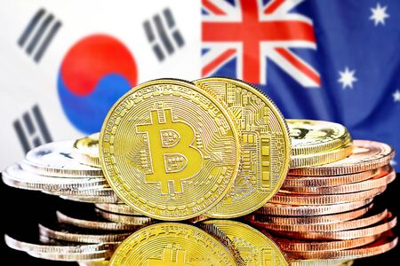 Concept for investors in cryptocurrency and Blockchain technology in the South Korea and Australia. Bitcoins on the background of the flag South Korea and Australia.