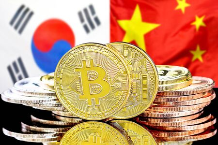 Concept for investors in cryptocurrency and Blockchain technology in the South Korea and China. Bitcoins on the background of the flag South Korea and China.