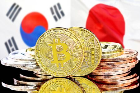 Concept for investors in cryptocurrency and Blockchain technology in the South Korea and Japan. Bitcoins on the background of the flag South Korea and Japan.