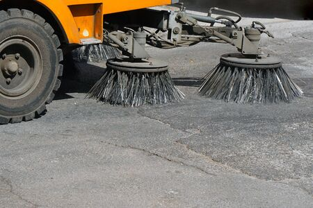 Street sweeper machine working. Street cleaning machine. Stock Photo