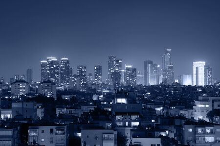 Night view of the city life. Light of the buildings shining with cool blue tones. View of night scene of Tel Aviv, Israel. Blue tone city scape.