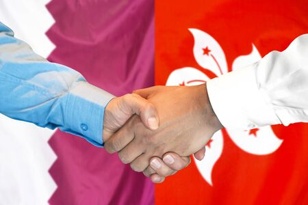 Business handshake on the background of two flags. Men handshake on the background of the Qatar and Hong Kong flag. Support concept
