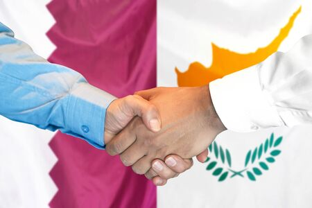 Business handshake on the background of two flags. Men handshake on the background of the Qatar and Cyprus flag. Support concept 写真素材