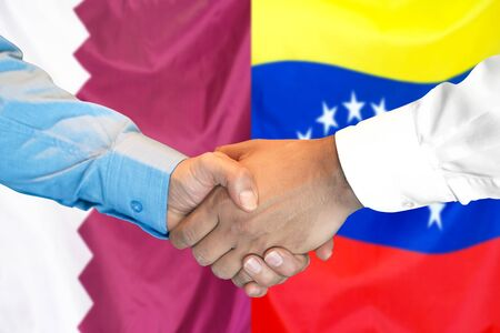 Business handshake on the background of two flags. Men handshake on the background of the Qatar and Venezuela flag. Support concept