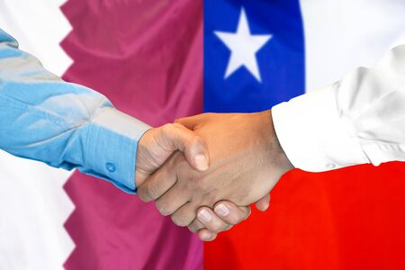 Business handshake on the background of two flags. Men handshake on the background of the Qatar and Chile flag. Support concept