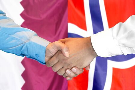 Business handshake on the background of two flags. Men handshake on the background of the Qatar and Norway flag. Support concept 写真素材