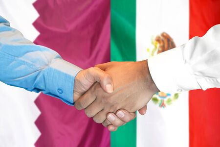 Business handshake on the background of two flags. Men handshake on the background of the Qatar and Mexico flag. Support concept