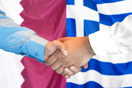 Business handshake on the background of two flags. Men handshake on the background of the Qatar and Greece flag. Support concept