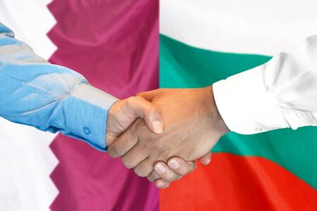 Business handshake on the background of two flags. Men handshake on the background of the Qatar and Bulgaria flag. Support concept