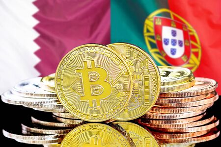 Concept for investors in cryptocurrency and Blockchain technology in the Qatar and Portugal. Bitcoins on the background of the flag Qatar and Portugal. Banco de Imagens