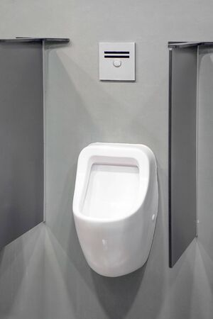 Close-up of toilet bowl. White toilet in the bathroom. Public toilet in the airport or restaurant, cafe. Stock fotó