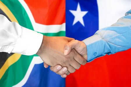 Business handshake on the background of two flags. Men handshake on the background of the South Africa and Chile flag. Support concept