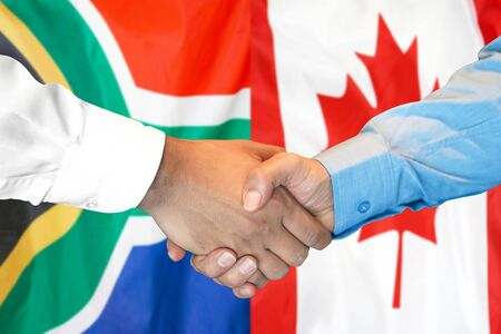 Business handshake on the background of two flags. Men handshake on the background of the South Africa and Canada flag. Support concept