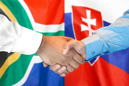 Business handshake on the background of two flags. Men handshake on the background of the South Africa and Slovakia flag. Support concept Stock fotó