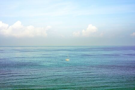 Yacht on the sea horizon on a summer day                               写真素材