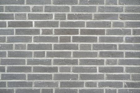 Gray Brick wall for background or texture. Old gray brick wall texture background
