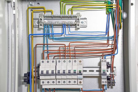 Electrical panel houses. The electrical box contains many terminals, relays, wires and switches.