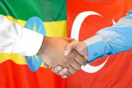 Business handshake on the background of two flags. Men handshake on the background of the Ethiopia and Turkey flag. Support concept