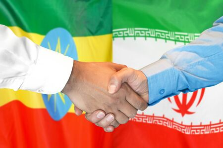 Business handshake on the background of two flags. Men handshake on the background of the Ethiopia and Iran flag. Support concept Zdjęcie Seryjne