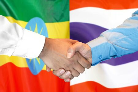 Business handshake on the background of two flags. Men handshake on the background of the Ethiopia and Thailand flag. Support concept