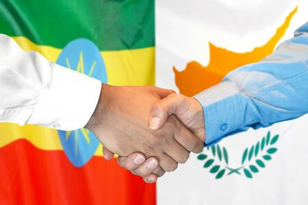 Business handshake on the background of two flags. Men handshake on the background of the Ethiopia and Cyprus flag. Support concept
