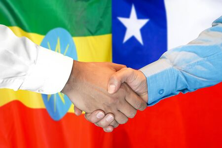 Business handshake on the background of two flags. Men handshake on the background of the Ethiopia and Chile flag. Support concept