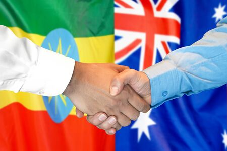 Business handshake on the background of two flags. Men handshake on the background of the Ethiopia and Australia flag. Support concept Zdjęcie Seryjne