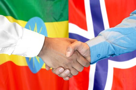 Business handshake on the background of two flags. Men handshake on the background of the Ethiopia and Norway flag. Support concept