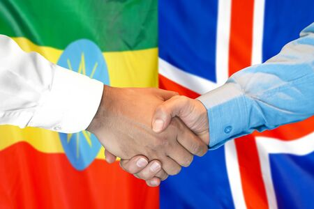 Business handshake on the background of two flags. Men handshake on the background of the Ethiopia and Iceland flag. Support concept