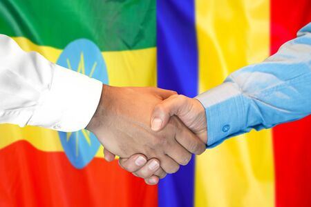 Business handshake on the background of two flags. Men handshake on the background of the Ethiopia and Moldova flag. Support concept