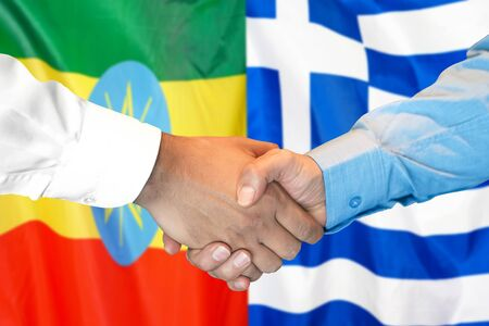 Business handshake on the background of two flags. Men handshake on the background of the Ethiopia and Greece flag. Support concept