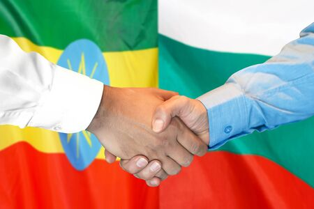 Business handshake on the background of two flags. Men handshake on the background of the Ethiopia and Bulgaria flag. Support concept