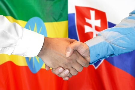 Business handshake on the background of two flags. Men handshake on the background of the Ethiopia and Slovakia flag. Support concept