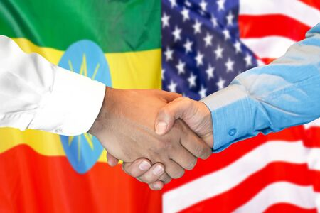 Business handshake on the background of two flags. Men handshake on the background of the Ethiopia and United States of America flag. Support concept Zdjęcie Seryjne