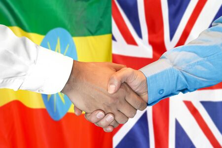 Business handshake on the background of two flags. Men handshake on the background of the Ethiopia and United Kingdom flag. Support concept Zdjęcie Seryjne